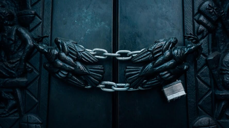 How to cooperate with SEO specialists - Limited access to Search Console and Google analytics means we can't help you - image of doors locked with chains